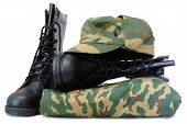 Camouflage uniform and two black leather army boots on isolated (white) background. poster