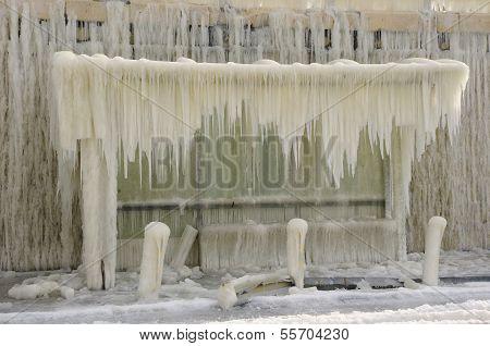 Frozen Breakwater And Bus Stop After Winter Storm