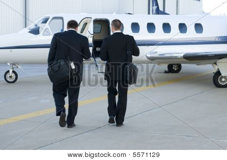 Businessmen Walking Toward Corporate Jet
