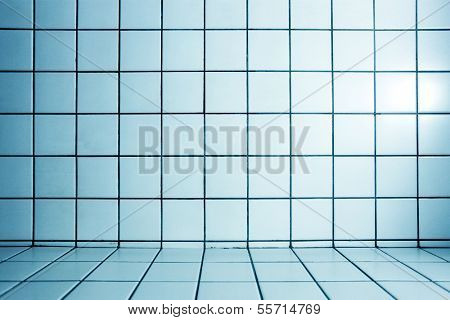 Background of beautiful modern turquoise luxury bathroom interior, blue glossy and clean ornamental stone tiled wall and floor in spacious domestic bath room and residential structure