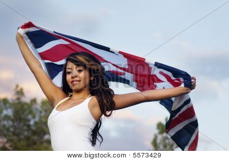 Woman holding and waving a British flag