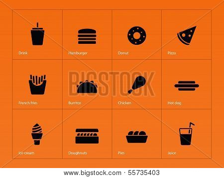 Fast food icons on orange background.