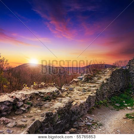 Ruins Of An Old Castle In The Mountains In Evening