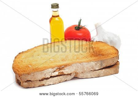 toasted bread, tomato, garlics and olive oil to make pa amb tomaquet, bread with tomato, typical of Catalonia, Spain