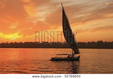 Felucca boat sailing on the Nile river at sunset Luxor Egypt poster