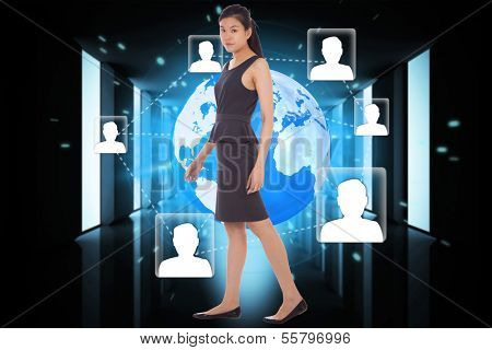 Asian businesswoman walking against bright room with windows