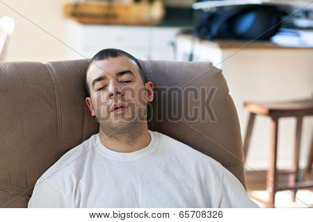 Lazy Man Sleeping On The Sofa