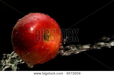 Apple And Stream Of Water