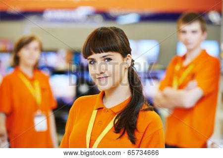 Positive team of shop assistants in supermarket store