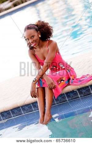 Stock image Happy Jamaican woman by the pool