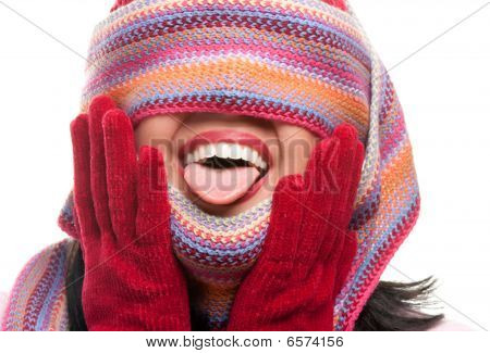 Attractive Woman With Colorful Scarf Over Eyes Sticking Out Tongue