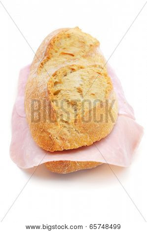 closeup of a spanish bocadillo de jamon de york, a ham sandwich, on a white background