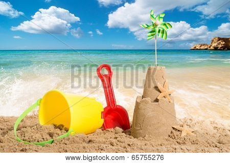 Sandcastle at the beach with bucket and spade