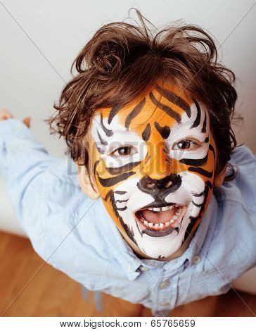 little cute boy with faceart on birthday party close up