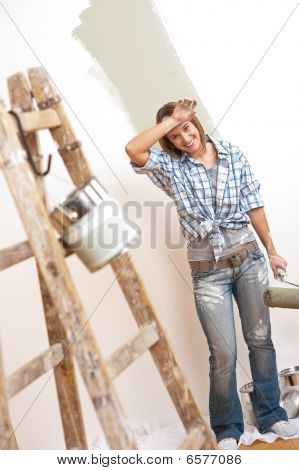 Home Improvement: Cheerful Woman With Paint Roller