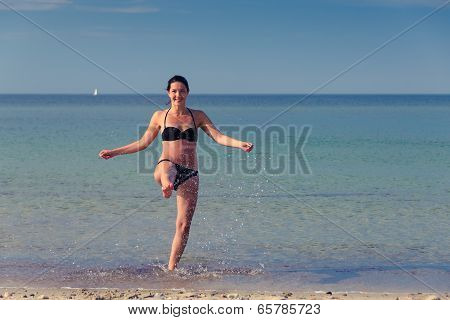 Happy Woman Frolicking On A Tropical Beach