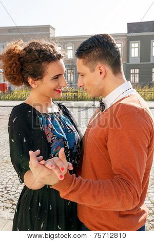 Retro Man In Love With Smiling Woman Looking Eye To Eye Each Other In The Old Town