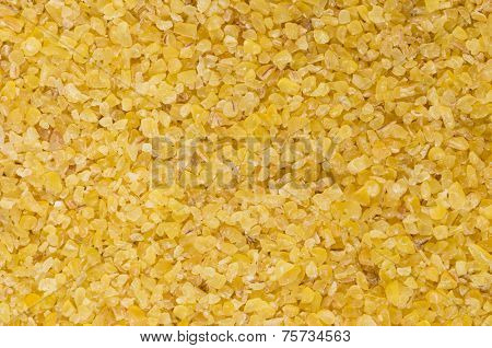 Macro photograph of raw, light-coloured, fine-ground burghul or bulgur wheat, a staple of the Middle Eastern diet and considered a health food in the West as it has a low glycemic index