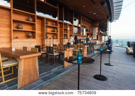 BANGKOK, THAILAND - NOV 29, 2013: The terrace of Octave rooftop Bar in Bangkok, Thailand. The Octave bar is located in the Thong Lor district near Sukhumvit road.