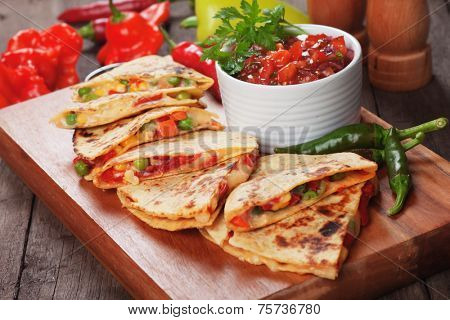 Mexican quesadillas with cheese, vegetables and salsa dipping sauce