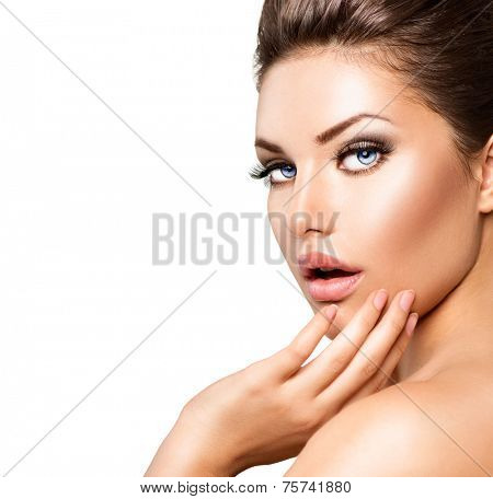 Beautiful young woman portrait. Beauty girl face. Perfect skin, skincare. Gorgeous lady with Clean Fresh Skin close up isolated on white. Spa Woman touching her skin