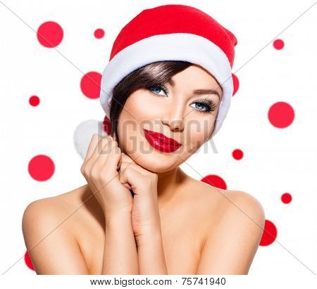 Christmas Woman. Beauty Model Girl in Santa Hat isolated on White Background. Holiday make up. Funny Smiling Surprised Woman Portrait. Red Lips and Manicure. Beautiful Holiday Makeup