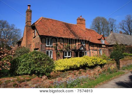 Medieval brick and timber cottage