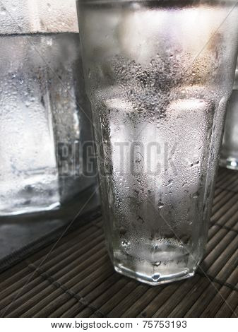 Glass of pure cold water - close up poster