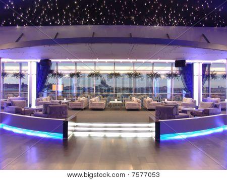 interior of a panoramic restaurant at night