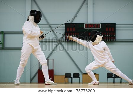 Little girl fencer and her trainer