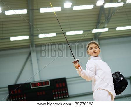 Little girl fencer with epee and mask
