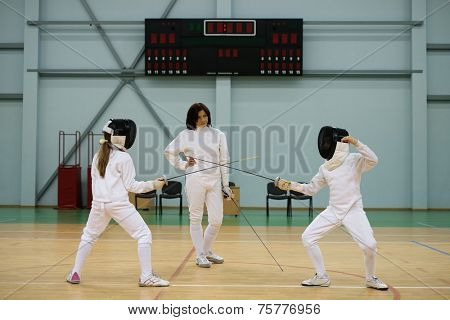 Children fencers and their  trainer