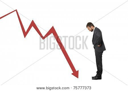 displeased businessman looking at red downturn graph. isolated on white background