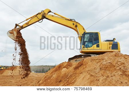 excavator machine at excavation earthmoving work in sand quarry
