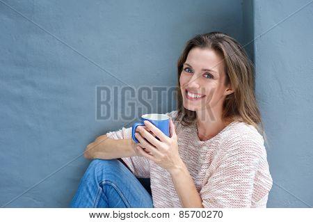 Beautiful Woman Enjoying A Drink Of A Coffee