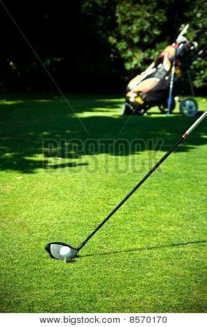 Driver, ball and golf bag