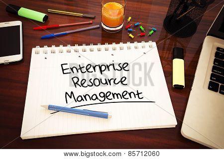 Enterprise Resource Management - handwritten text in a notebook on a desk - 3d render illustration. poster