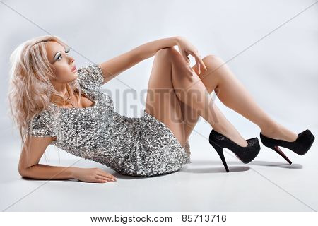 Girl In Silver Dress And Shoes.