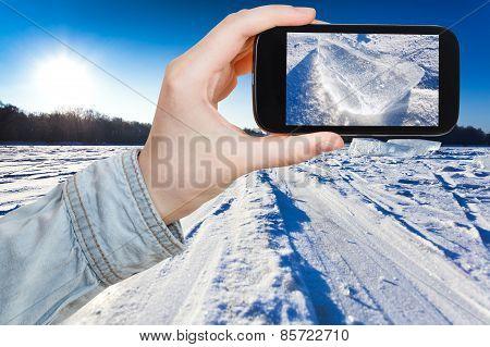 Tourist Photographs Of Ski Track At Snow Field