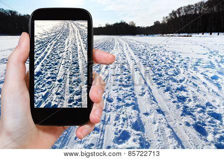 Tourist Photographs Of Ski Runs In Snowy Field