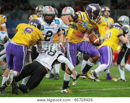 VIENNA, AUSTRIA - MARCH 23, 2014: RB Emmanuel Pan-Sok Moody (#1 Vikings) runs with the ball in an AFL football game.