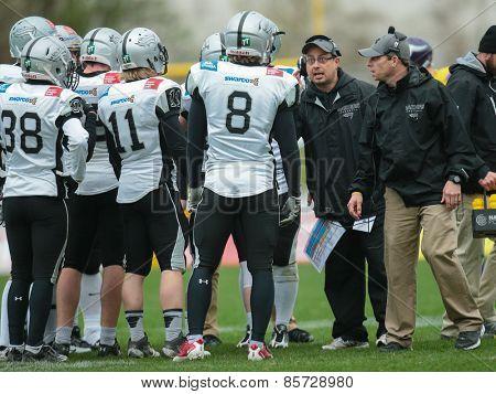 VIENNA, AUSTRIA - MARCH 23, 2014: Head Coach Shuan Fatah talks to his team in an AFL football game.