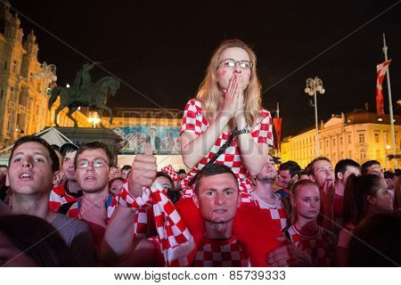 ZAGREB, CROATIA - JUNE 12, 2014: Croatian football fans at Ban Josip Jelacic square support their national team during the world cup match between Croatia and Brazil.