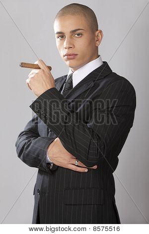 Good Looking Businessman On Gray
