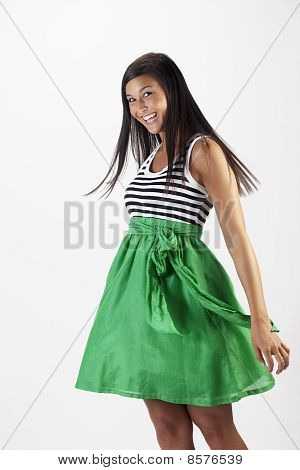 Attractive Young Woman in a Green Skirt