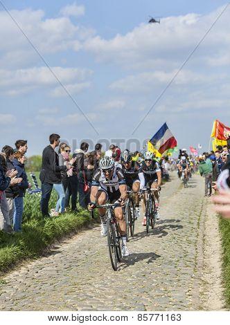 Three Cyclists On Paris-roubaix 2014