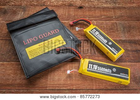 Fort Collins, CO, USA - March 18, 2015:  LiPo (lithium polymer) batteries used in drones and RC model with protective charging bags.