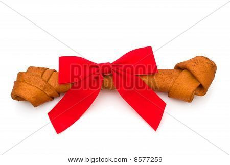 A dog bone with a bow isolated on a white background Dog treat poster