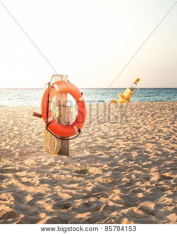Life preserver on sandy beach somewhere in Mexico poster