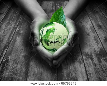 green world in the heart hand - - Elements of this image are furnished by NASA